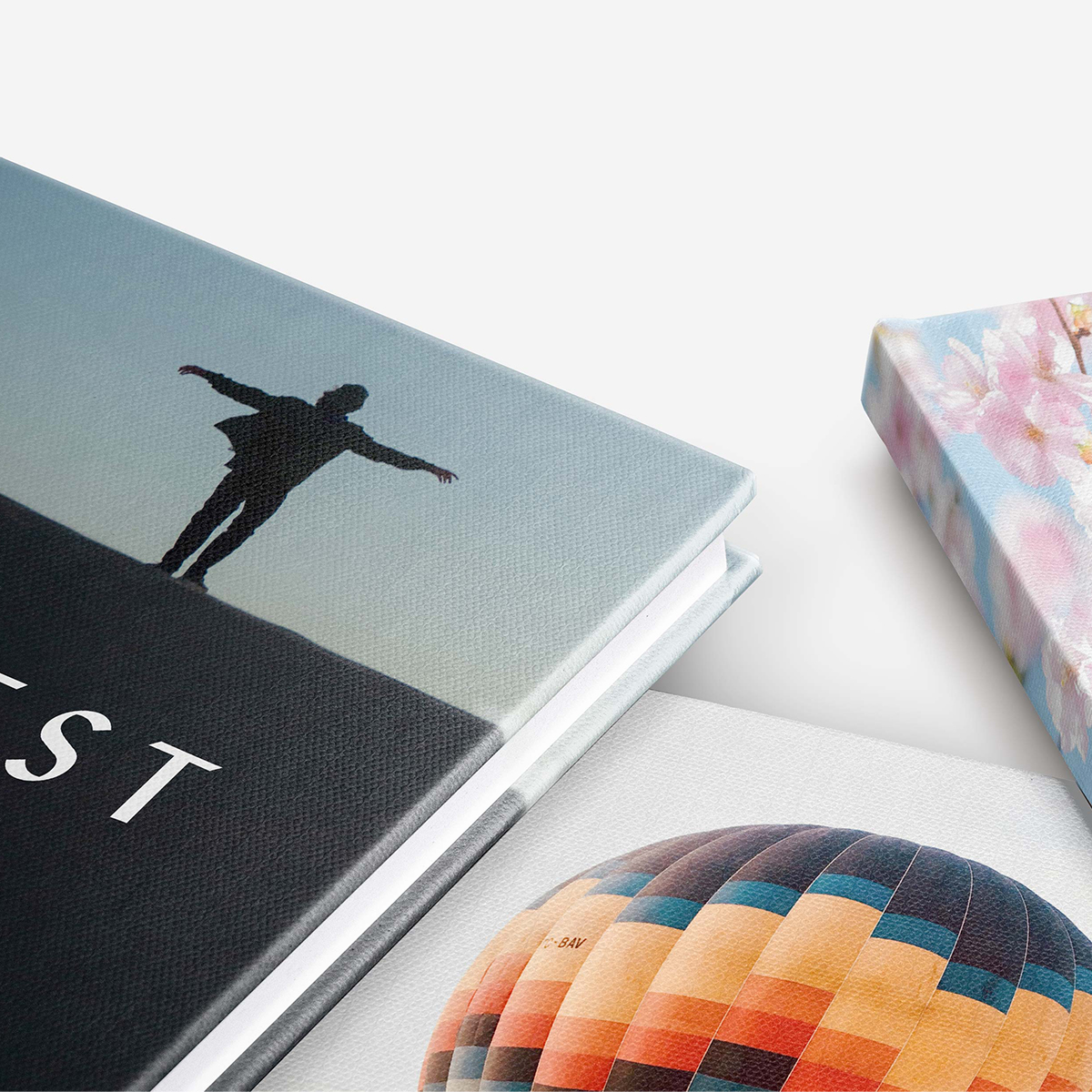 Zoomed in on covers of three Artifact Uprising Photo-Wrapped Hardcover Books showing the high quality results of the press printing process