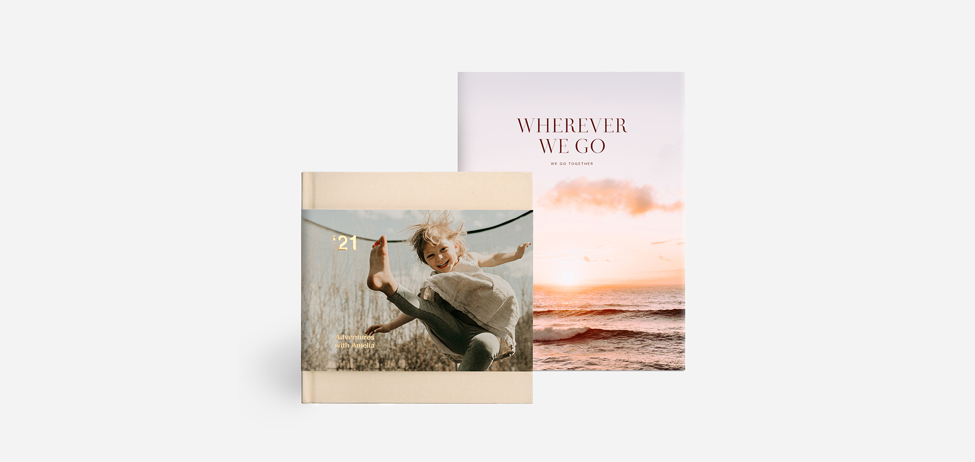 Artifact Uprising Hardcover Photo book with partial dust jacket and digital foil lettering next to Artifact Uprising Hardcover Photo Book with full dust jacket featuring image of ocean sunset