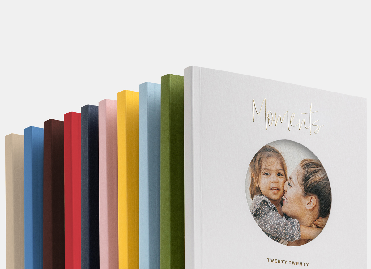 all 10 colors of the artifact uprising color series photo book lined up in a row