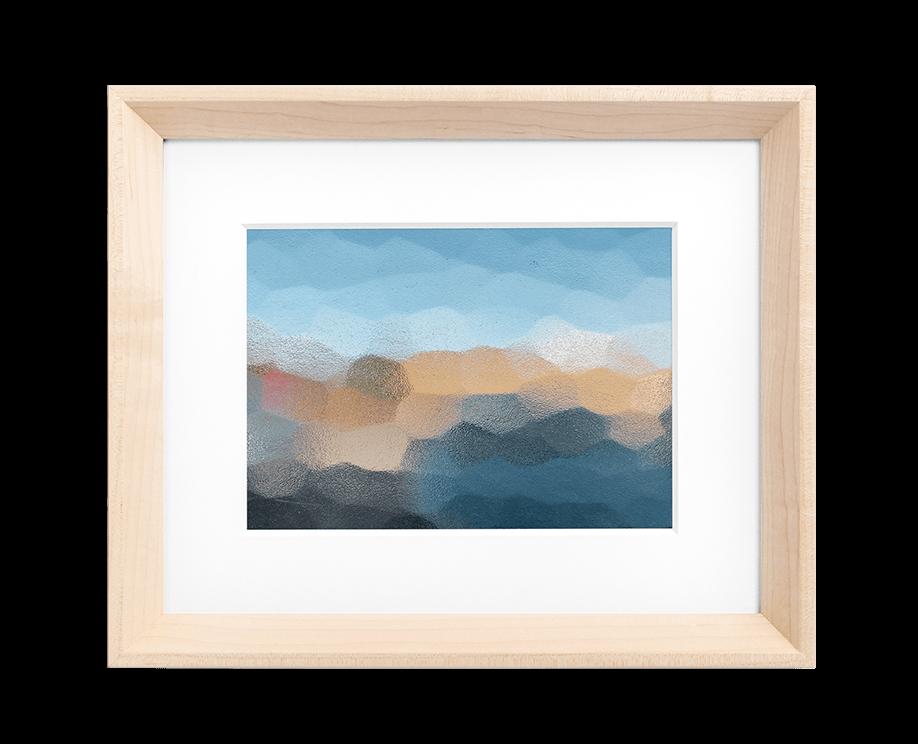 A tile-like design with predominantly black, blue, and orange coloring framed in a light wood frame