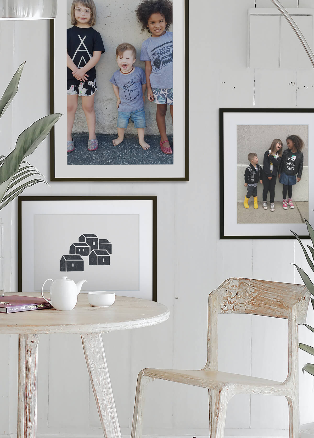 Asymmetrical gallery wall hung behind dining table