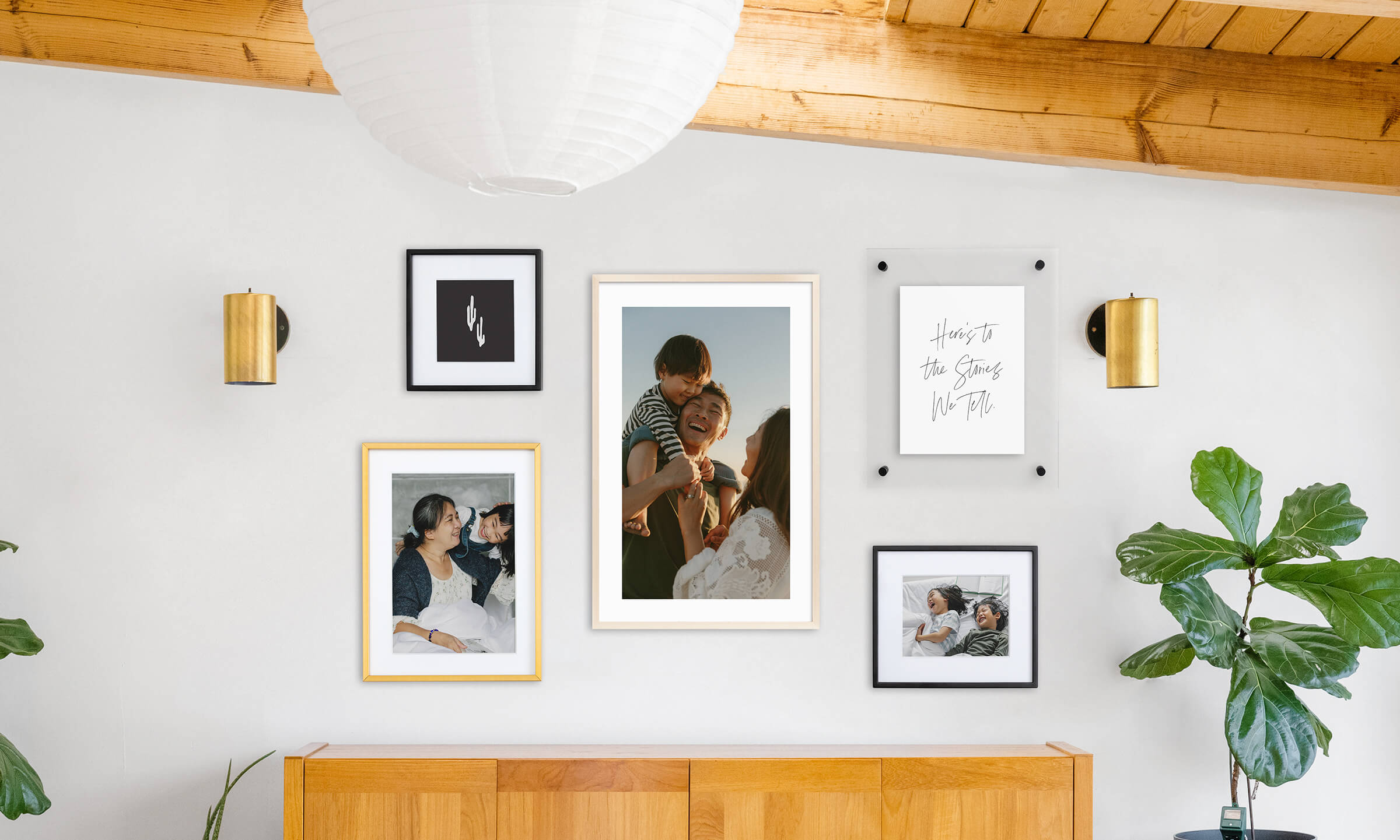 Gallery wall that mixes and matches sizes, styles, and finishes.