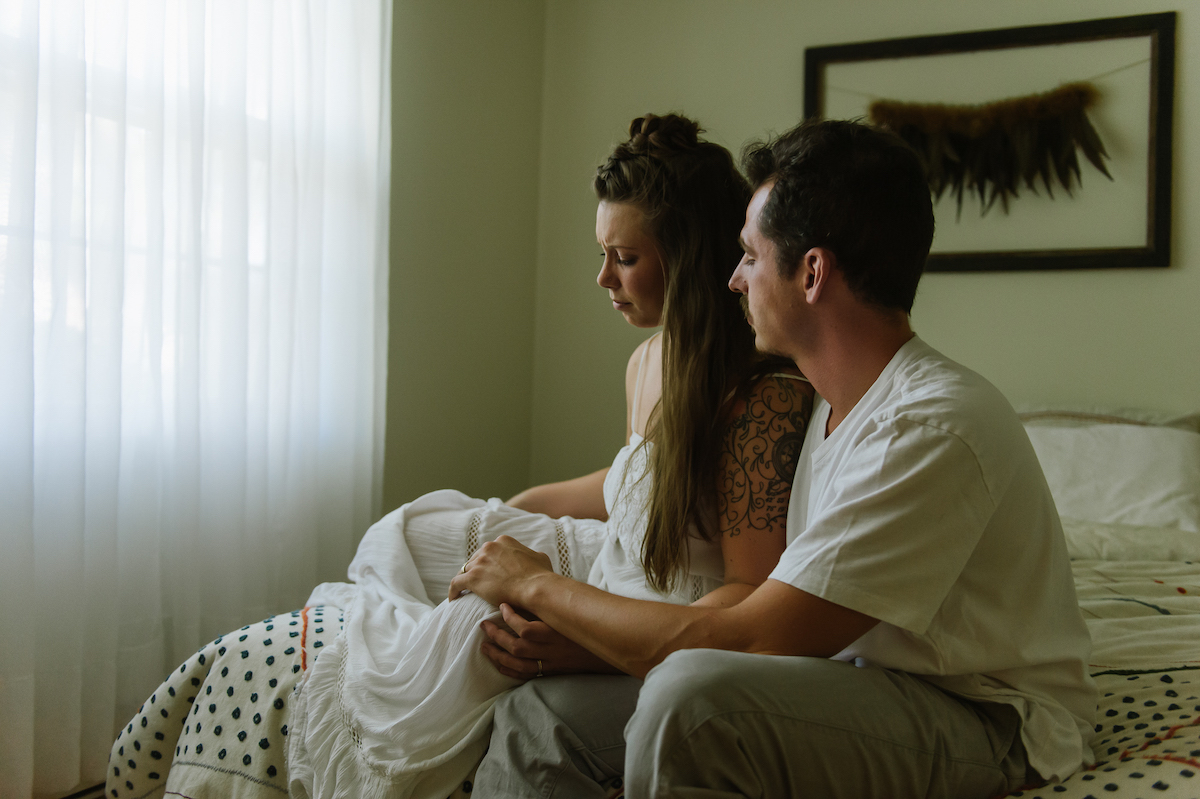 Portrait of husband consoling wife taken by Martha Swann-Quinn