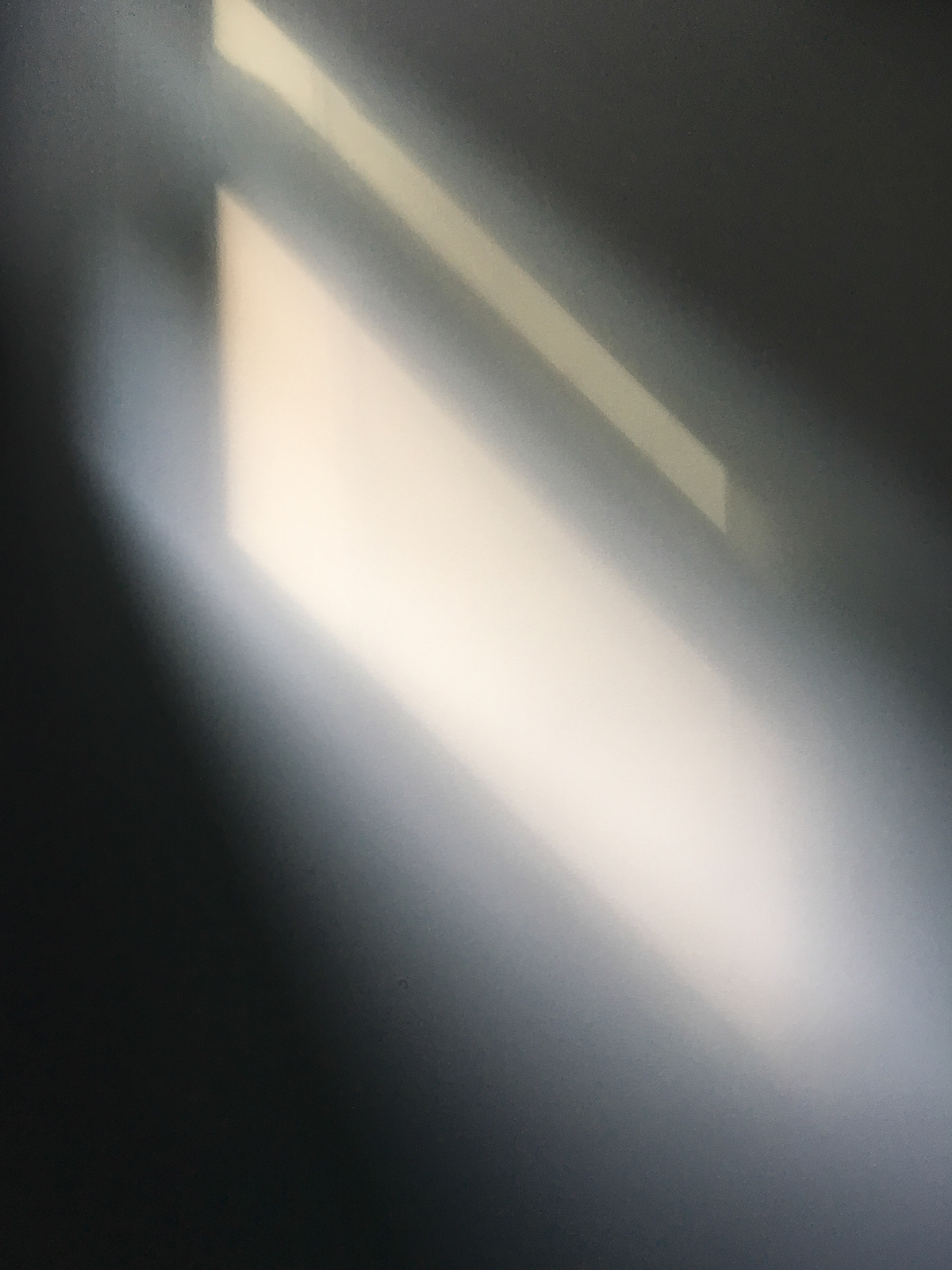 Reflection of light from the window on the wall