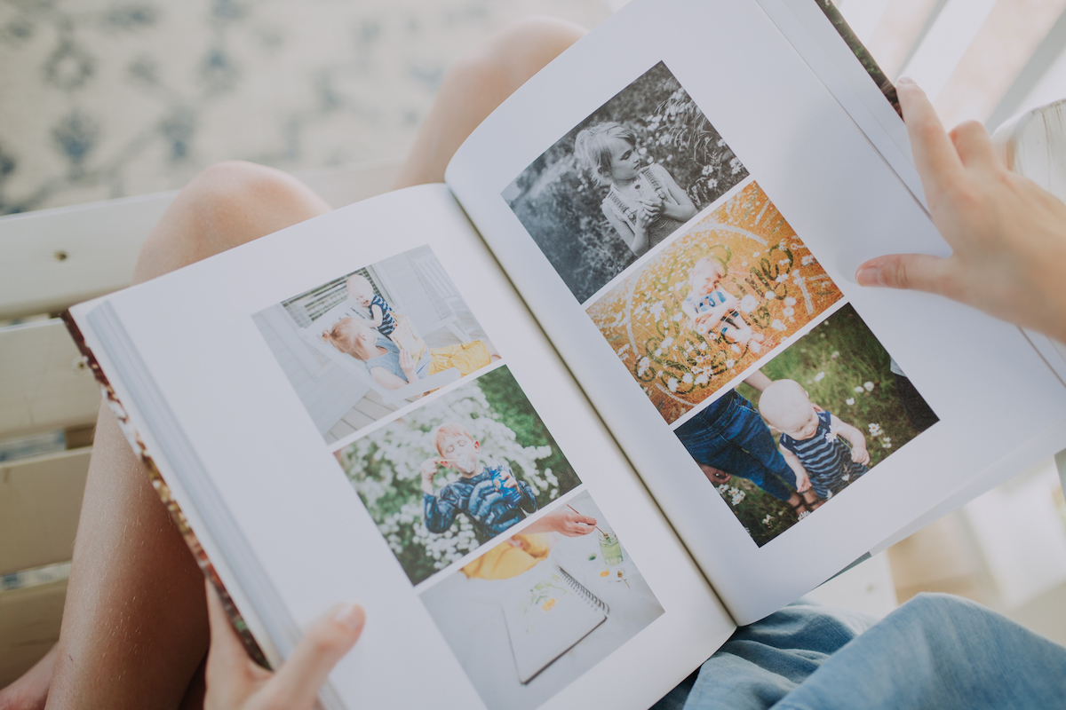 Zoomed in on interior Artifact Uprising Hardcover Photo Book featuring a variety of family photos