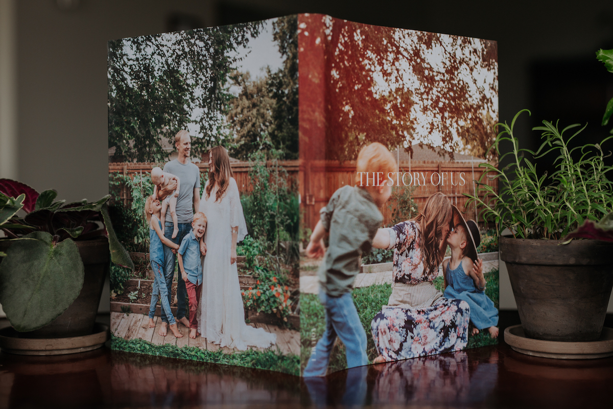 Artifact Uprising Hardcover Photo Book standing open on table with dust jacket turned to the camera