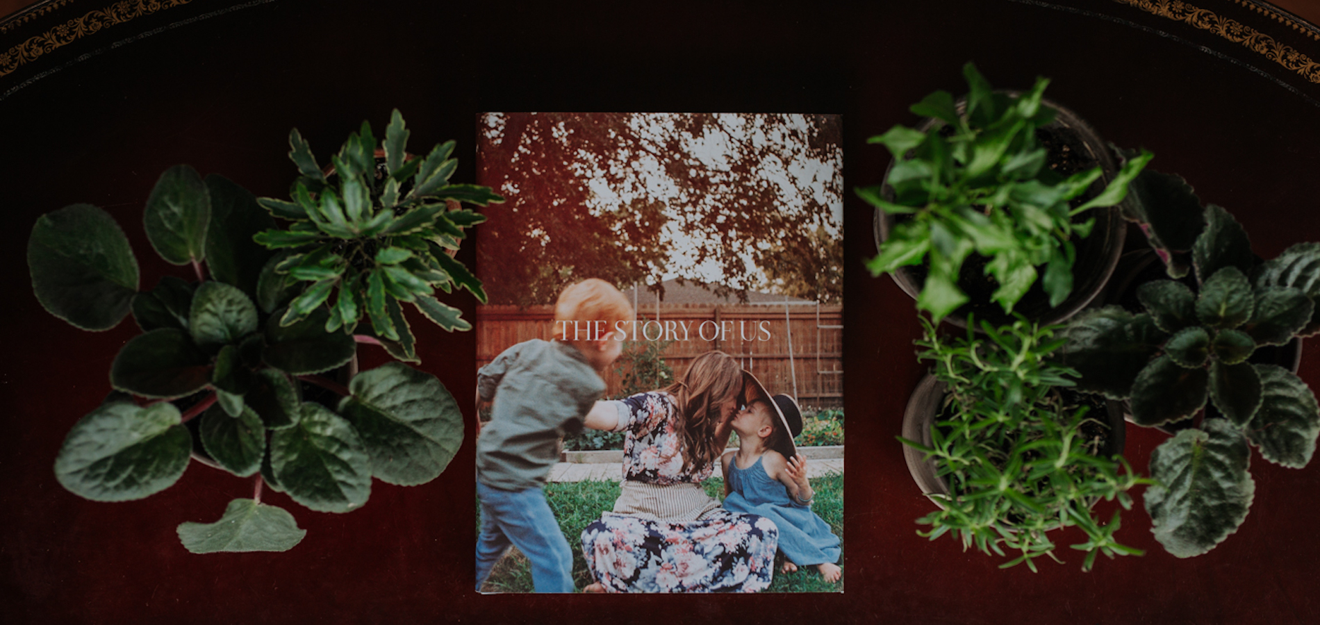 Artifact Uprising Hardcover Photo Book titled The Story of Us featuring family photo of mother with two young children