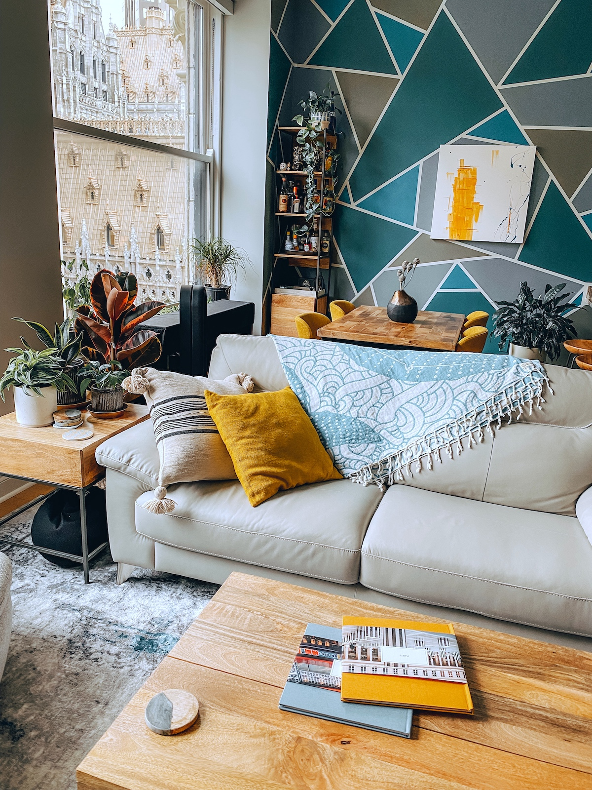 An Artifact Uprising Hardcover Photo Books on coffee table in artsy apartment with honeycomb decor accents